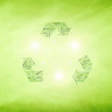 Conceptual green eco recycle symbol. Creative green color recycle symbol with place for text on blurry green background. Lovely recycle symbol with added Royalty Free Stock Photos