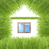 Conceptual green grass house isolated on white Stock Image