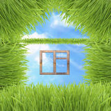 Conceptual green grass house on sky background Stock Photography