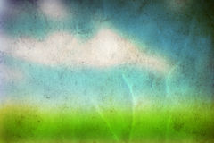 Conceptual green grass and sky old paper. Conceptual green summer grass and blye sky on old paper vintage background Stock Photos