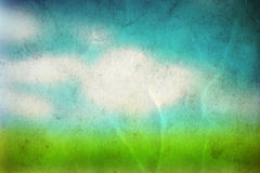 Conceptual green grass and sky old paper. Conceptual green summer grass and blye sky on old paper vintage background Royalty Free Stock Photography