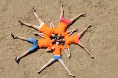 Conceptual guys. Cheerful young people having fun on a beach. Great summer holidays stock photography