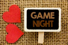 Conceptual hand text showing Game Night. Business photo showcasing Entertainment Fun Play Time Event For Gaming written on blackbo. Conceptual hand text showing royalty free stock photo
