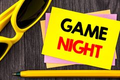 Conceptual hand text showing Game Night. Business photo showcasing Entertainment Fun Play Time Event For Gaming written on Stiky N. Conceptual hand text showing royalty free stock images