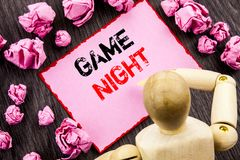 Conceptual hand text showing Game Night. Concept meaning Entertainment Fun Play Time Event For Gaming written on Sticky Note Holdi. Conceptual hand text showing royalty free stock images