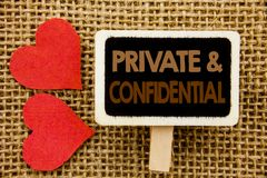 Conceptual hand text showing Private And Confidential. Business photo showcasing Security Secret Sensitive Classified Information. Written blackboard the Royalty Free Stock Images