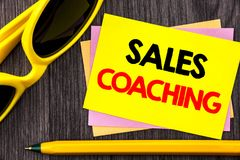Conceptual hand text showing Sales Coaching. Business photo showcasing Business Goal Achievement Mentoring written on Stiky Note P royalty free stock images