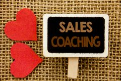 Conceptual hand text showing Sales Coaching. Business photo showcasing Business Goal Achievement Mentoring written on blackboard o. Conceptual hand text showing Royalty Free Stock Photos