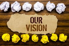 Conceptual hand text word Our Vision. Business concept for Marketing Strategy Vision Written on sticky note, wooden with sticky, m Stock Photography