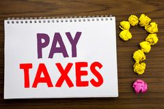 Conceptual hand writing caption inspiration showing Pay Taxes. Business concept for Taxation Overtax Return written on notepad not. Conceptual hand writing Stock Photo