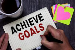 Conceptual hand writing showing Achieve Goals. Business photo text Results oriented Reach Target Effective Planning Succeed Man ho. Lding marker giving ideas stock photography