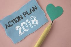 Conceptual hand writing showing Action Plan 2018. Business photo showcasing Plans targets activities life goals improvement develo. Pment written Tear Note paper Royalty Free Stock Photography