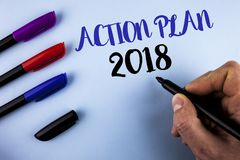 Conceptual hand writing showing Action Plan 2018. Business photo text Plans targets activities life goals improvement development. Written by Man plain Royalty Free Stock Image