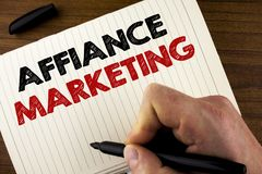 Conceptual hand writing showing Affiance Marketing. Business photo showcasing joining two or more companies in same field mutual g. Oal written by Man Notebook Royalty Free Stock Image