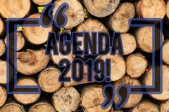 Conceptual hand writing showing Agenda 2019. Business photo text list of items to be discussed at formal meeting or. Conceptual hand writing showing Agenda 2019 royalty free stock images