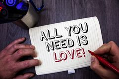 Conceptual hand writing showing All You Need Is Love Motivational. Business photo showcasing Deep affection needs appreciation rom. Ance Man hold holding red stock images