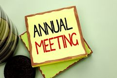 Conceptual hand writing showing Annual Meeting. Business photo showcasing Yearly Company Assembly Business Conference Report Event. Written Sticky Note Paper royalty free stock photography