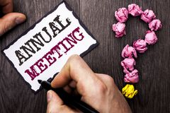 Conceptual hand writing showing Annual Meeting. Business photo text Yearly Company Assembly Business Conference Report Event writt. En by Man Sticky Note Holding stock images