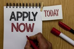 Conceptual hand writing showing Apply Now. Business photo text An act of a person to acquire the job related to the profession Man. Holding marker notebook stock photography