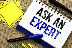 Conceptual hand writing showing Ask An Expert. Business photo showcasing Consult a Professional Asking for Advice Make a Question. Written Notebook Book the Stock Image