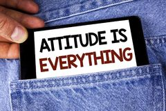Conceptual hand writing showing Attitude Is Everything. Business photo text Motivation Inspiration Optimism important to succeed w. Ritten Mobile phone holding Royalty Free Stock Photos