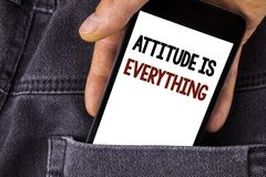 Conceptual hand writing showing Attitude Is Everything. Business photo text Motivation Inspiration Optimism important to succeed w. Ritten Mobile Phone holding Stock Photography