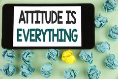 Conceptual hand writing showing Attitude Is Everything. Business photo text Motivation Inspiration Optimism important to succeed w. Ritten Mobile Phone Screen Stock Image
