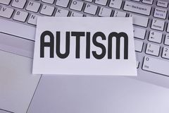 Conceptual hand writing showing Autism. Business photo showcasing Autism Awareness conducted by social committee around the globe. Written White Sticky Note Royalty Free Stock Images