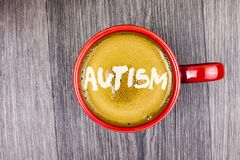 Conceptual hand writing showing Autism. Business photo text Autism Awareness conducted by social committee around the globe writte. N Coffee in Red Cup Grey Royalty Free Stock Photos