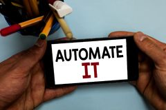 Conceptual hand writing showing Automate It. Business photo showcasing convert process or facility to be operated automatic equipm. Ent. Man holding cell phone royalty free stock photography
