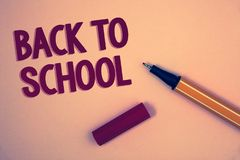 Conceptual hand writing showing Back To School. Business photo showcasing Return to class first day of studies Classroom Arriving. Words yellow background open royalty free stock photos