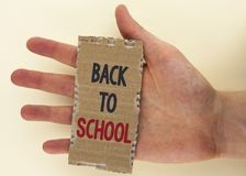 Conceptual hand writing showing Back To School. Business photo text Right time to purchase schoolbag, pen, book, stationary writte. N Tear Cardboard Piece the Royalty Free Stock Photos