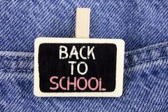 Conceptual hand writing showing Back To School. Business photo text Right time to purchase schoolbag, pen, book, stationary writte. N Wood Piece the Jeans Stock Image