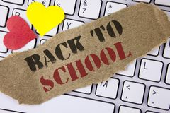 Conceptual hand writing showing Back To School. Business photo text Right time to purchase schoolbag, pen, book, stationary writte. N Tear Cardboard Piece placed Royalty Free Stock Image