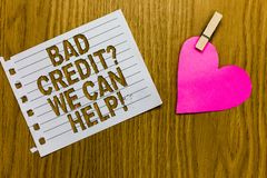 Conceptual hand writing showing Bad Credit question We Can Help. Business photo showcasing Borrower with high risk Debts Financial. Yellow woody deck word with stock photography