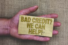 Conceptual hand writing showing Bad Credit question We Can Help. Business photo showcasing Borrower with high risk Debts Financial. Thick gray paper with words royalty free stock image