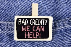 Conceptual hand writing showing Bad Credit Question We Can Help Motivational Call. Business photo text achieve good debt health wr. Itten Wood Piece the Jeans Stock Photography
