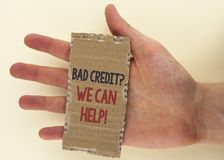 Conceptual hand writing showing Bad Credit Question We Can Help Motivational Call. Business photo text achieve good debt health wr. Itten Tear Cardboard Piece Royalty Free Stock Photo