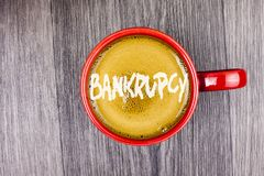 Conceptual hand writing showing Bankrupcy. Business photo text Company under financial crisis goes bankrupt with declining sales w. Ritten Coffee in Red Cup Grey stock images