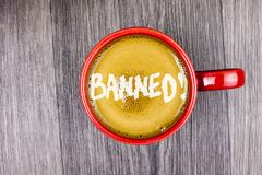 Conceptual hand writing showing Banned Motivational Call. Business photo text Ban on use of steroids, No excuse for building Muscl. Es. written Coffee in Red Cup stock images