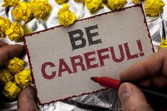 Conceptual hand writing showing Be Careful. Business photo showcasing Caution Warning Attention Notice Care Beware Safety Security. Written by Man Holding Royalty Free Stock Image