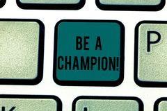 Conceptual hand writing showing Be A Champion. Business photo text Triumph in a competition sport the winner of a. Contest Keyboard key Intention to create stock photography