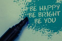 Conceptual hand writing showing Be Happy Be Bright Be You. Business photo showcasing Self-confidence good attitude enjoy cheerful. Sprinkle blue color on floor royalty free stock image