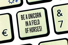 Conceptual hand writing showing Be A Unicorn In A Field Of Horses. Business photo text Make the difference being special royalty free stock image