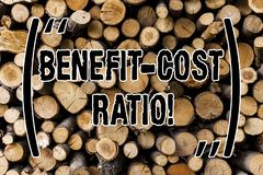 Conceptual hand writing showing Benefit Cost Ratio. Business photo showcasing Relationship between the costs and benefits of. Project Wooden background vintage stock photo