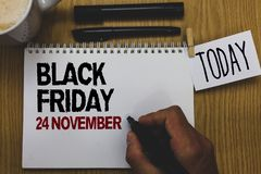 Conceptual hand writing showing Black Friday 24 November. Business photo text Special sales Thanksgiving discounts Clearance Writt. En on paper hand hold pen stock image