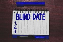 Conceptual hand writing showing Blind Date. Business photo text Social engagement with a demonstrating one has not royalty free stock photography