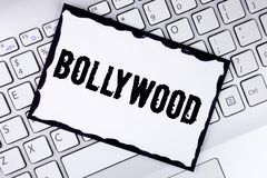 Conceptual hand writing showing Bollywood. Business photo showcasing Indian cinema a source of entertainment written on White Stic. Conceptual hand writing Stock Image