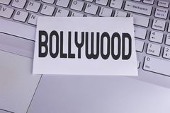 Conceptual hand writing showing Bollywood. Business photo showcasing Indian cinema a source of entertainment written on White Stic. Conceptual hand writing Royalty Free Stock Photography