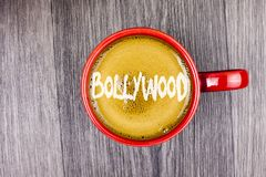 Conceptual hand writing showing Bollywood. Business photo text Indian cinema a source of entertainment written on Coffee in Red Cu. Conceptual hand writing stock photos
